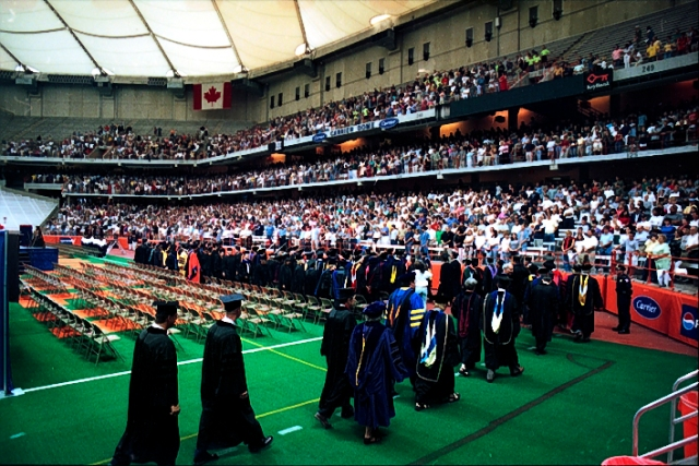 Convocation platform party and faculty procession toward the stage.