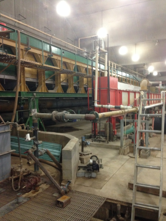 Shot from floor of facility, showing sump and pumps. Grad students are trained in experimental setup and equipment maintenance.