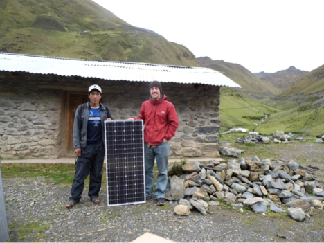 ERE Student TJ Decker with Heimenegildo Apaza Eihame with a solar panel that was installed in his home
