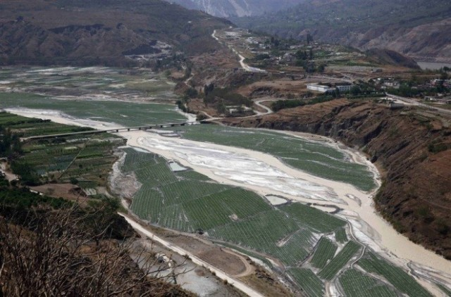 A stream turned white due to waste water discharge from nearby mining industries in Yunnan Province, China.
