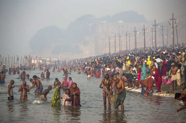 Pilgrims bath in the Ganges River during the Kumbh Mela.
