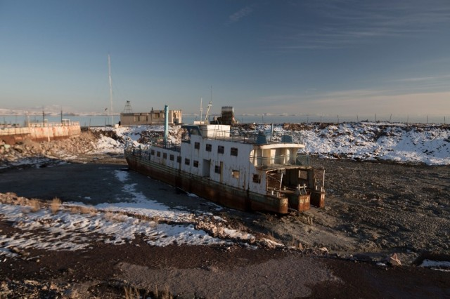 An abandoned ship rusts in the mud on the south shore of Lake Urmia (The New York Times)