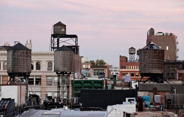 SoHo skyline with a number of rooftop water towers.