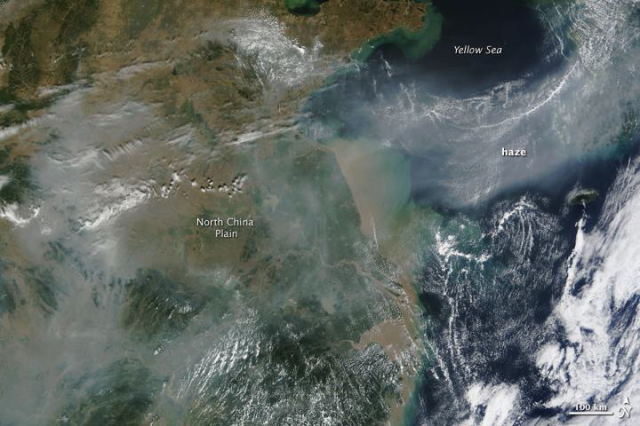 Figure 1 – Air pollution sourced from dense cities in China visible from space as it blows off-land. Implementing the proposed geoengineering technology could reduce air pollution. (Photo sourced from http://eoimages.gsfc.nasa.gov/images/imagerecords/40000/40557/China_TMO_2009275.jpg )