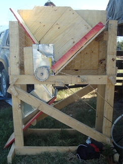 Compost sifter frame as reconstructed in Haiti, with chain leading to rear wheel of bike.