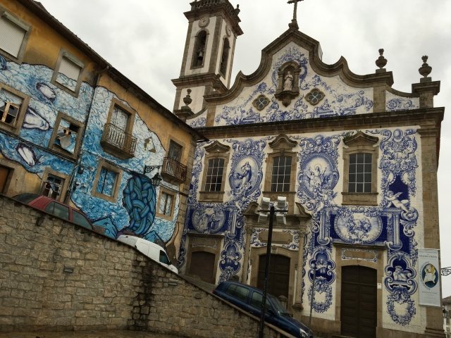 Covilha wool themed graffiti set alongside church tiles from the town's 19th century era as Royal Textile Factory.